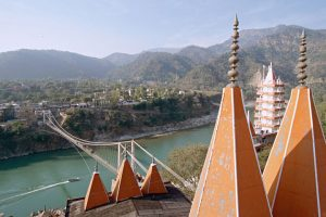 Rishikesh is on the Ganges river, 1,220 feet up in the foothills of the magnificent Himalayan mountains. Here I wanted to visually connect the foothills, Rishikesh on the far side of the Ganges, and two temples in the foreground, taken from the roof of one of the temples.