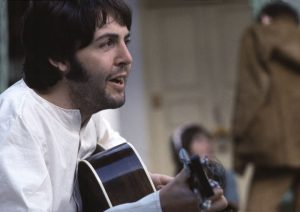 This is my all-time favourite shot of Paul. The gentle sensitivity in his eyes, the joyful smile on his lips, even mid-serenade, are part of the enormous playful creativity he embodies.
