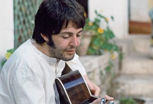 At times, photographers intentionally take photos that are slightly out of focus for the soft effect it creates. In this case, I just missed finding sharp focus, but it has such a gentle and textured feel that it works well for Paul as he's dreamily strumming.